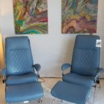 Two beautiful sparrow blue ekornes recliners.